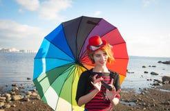 Clown met paraplu Stock Afbeelding