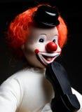 Clown met voet in zijn mond Royalty-vrije Stock Afbeeldingen