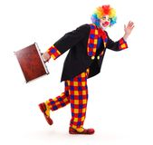 Clown mit Aktenkoffer Stockfotografie