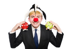 Clown mit piggybank Stockfotografie