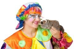 Clown mit Waschbären Stockfotografie