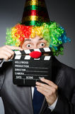Clown with the movie Stock Photos