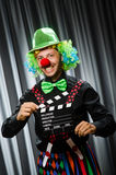 Clown with movie clapper Royalty Free Stock Images