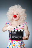 Clown with movie clapper Stock Photography