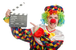Clown with movie clapper isolated on white Royalty Free Stock Photography