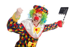 Clown with movie clapper isolated on white Stock Image