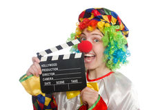 Clown with movie clapper isolated on white Stock Images