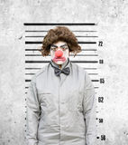 Clown Mug Shot. Lady Clown Has Her Identification Mug Shot Taken Against The Height Wall Down At The Police Station Stock Images