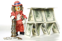 Clown near a dollar house Stock Photography