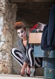 Clown Near Luggage. Cute female comedia del arte performer next to luggage Stock Image