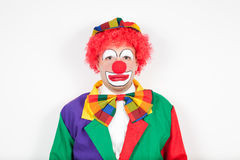 Clown with neutral face. On white stock images