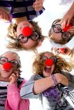 Clown Nosed Kids Looking Down Royalty Free Stock Photo