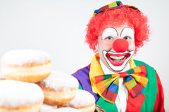 Clown with pancakes Stock Images