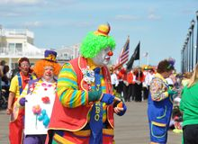 Clown parade on boardwalk Royalty Free Stock Photography