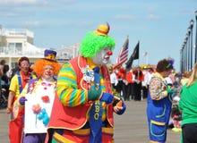 Clown parade on boardwalk. Clown walking in parade  atSeaside Park, NJ. Taken August 16, 2014 Royalty Free Stock Photography