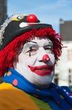 Clown peint coloré avec un chapeau. Photographie stock