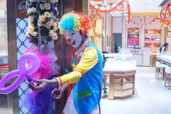 The clown performance twisted the balloon Stock Photo