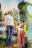 Clown Performing by Covering a Person in a Giant Bubble Stock Images