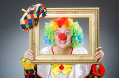 Clown with picture frame in funny concept Royalty Free Stock Image