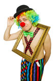 Clown with picture frame isolated Stock Photo