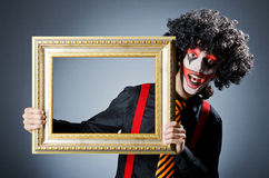Clown with picture frames Stock Photography
