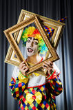 Clown with picture frames Stock Photo