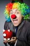 Clown with piggybank Royalty Free Stock Photography