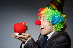 Clown with piggybank Stock Image