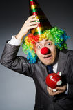 Clown with piggybank Stock Images