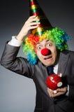 Clown with piggybank Stock Images