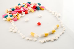 Clown in pills Stock Photo