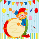 Clown playing the drum Stock Image