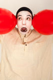 The clown is playing with red balloons Royalty Free Stock Photos