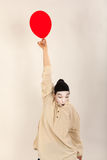 The clown is playing with red balloons Stock Image