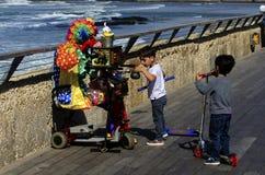 Clown playing in Tel-Aviv harbor Stock Images