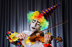 Clown playing on  violin Royalty Free Stock Photo