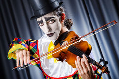 Clown playing on  violin Stock Photography