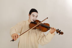 The clown is playing the violin Royalty Free Stock Photography