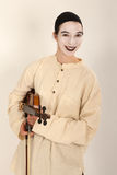 The clown is playing the violin Royalty Free Stock Image