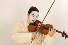The clown is playing the violin Stock Photos