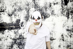 Clown pointing. Crazy clown mask halloween costume and fear stock images