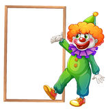 A clown pointing at the white board vector illustration