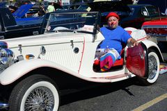 Clown posing. From a 1952 MG TD seen at the Maspeth 2012 Annual Antique Car Show Stock Photography