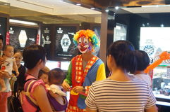 Clown promotions. China National Day, Xixiang Shenzhen shopping mall, there are clown promotions, people in the crowd Stock Image