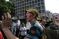 Clown protester. Royalty Free Stock Photo