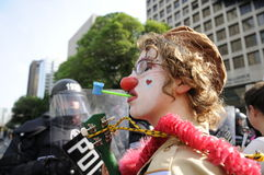 Clown protester blowing bubbles. Royalty Free Stock Photos