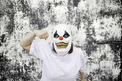 Clown punch. Crazy clown mask halloween costume and fear royalty free stock photos