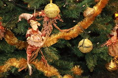 Clown puppet against Christmas decorated tree Stock Image