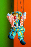 Clown puppet toy on bright background Stock Photo