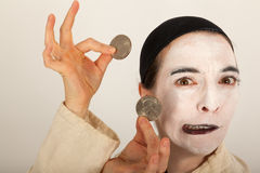 The clown with a purse and coins in his hand Stock Image